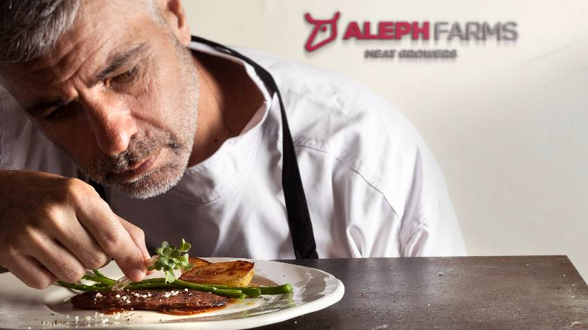 Chef of Aleph Farms next to its new cell-based steak prorotype